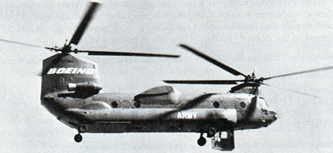 This is Boeing Vertol's 347, built to test HLH systems and concepts. A retractable cargo-operator's cockpit facing rearwards was fitted just in front of the forward landing gear.