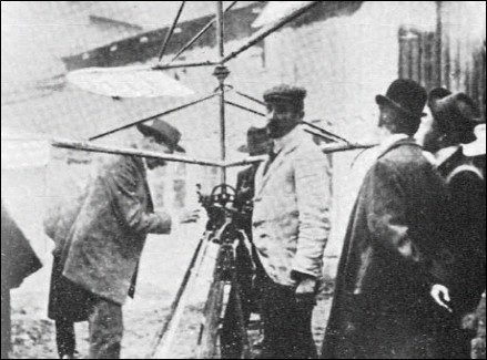 Tanski's helicopter fitted with a 2.5hp Anzani two-cylinder vee engine, with the designer (in white jacket) standing beside the machine, photographed in the courtyard at 2 Mazowiecka Street.